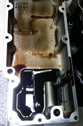 Golf Tee in Oil Pan